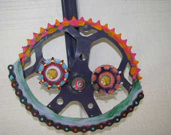 upCYCLED smiley from vintage bike parts. Wall art for indoors or out.