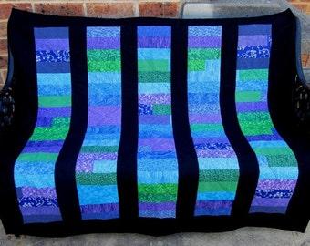 Multi-coloured lap quilt