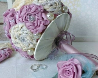 A unique handmade dusty pink & cream bridal bouquet with matching buttonhole