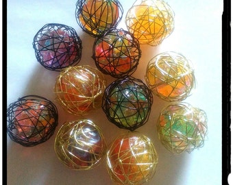 Wish ball in the cage, black or gold, wish-fulfillment