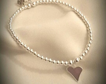 Sterling Silver 3mm round beaded Bracelet finished with Sterling Silver Heart Charm approx 11mm wide and 12mm high.