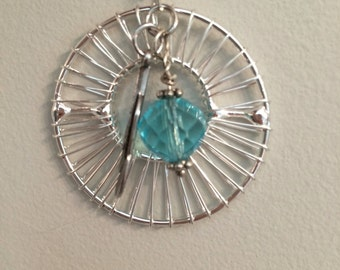 Here comes the Sun - silver pendant with a touch of color.