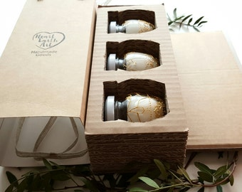 Box with 3 candles