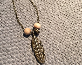 chain with feather pendant, wooden beads