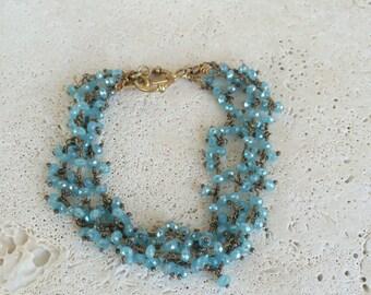 Blue beaded mulit strand bracelet