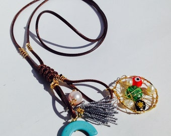 Leather necklace with dream catcher amulet of luck and love.