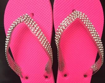 Hot pink flip flops.