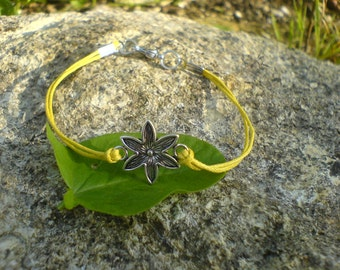 Cotton bracelet form a small flower