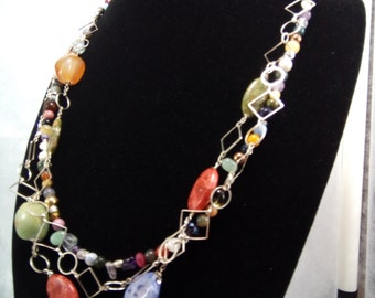 Multi strand necklace made of various Natural Gemstones in festive colors