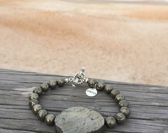 Natural pyrite beaded bracelet with small and a big statement piryte rock and tibetan closure