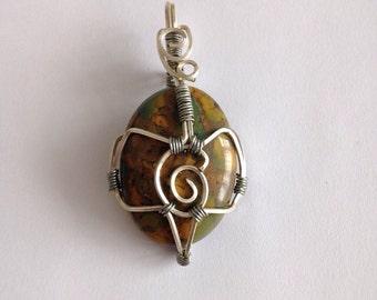 Wire wrapped fruit jasper pendant