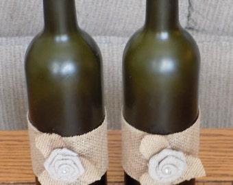 Burlap embellished wine bottle for centerpieces or home decor.