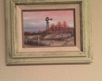 Hand painted and distressed rustic wood frame with windmill pjoto