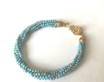 Luminonus blue/gold bracelet