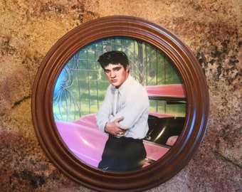 Looking at a Legend Collector plate of the young Elvis Presley (The King Of Rock and Roll)