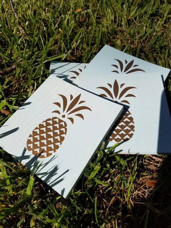 Light blue washed coaster with gold pineapple