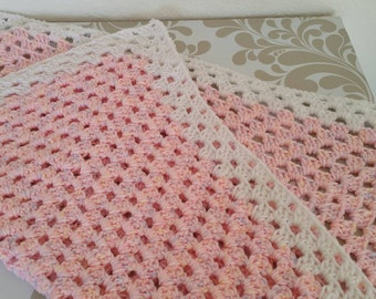 Baby blanket with sparkling multi colored pink with white trim