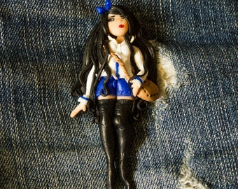 Girl in black (brooch) art doll