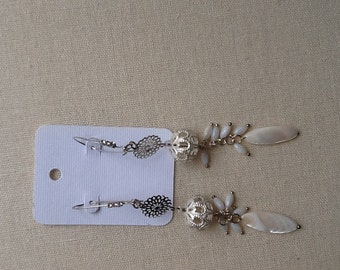 Long silver earrings with chrysanthemum charms, ornate delicate silver beads and mother of pearl dangles