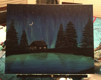 Cabin by the water painting