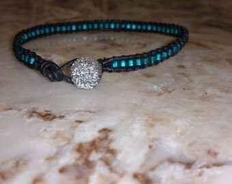 Black leather beaded bracelet w/ turquoise colored beads