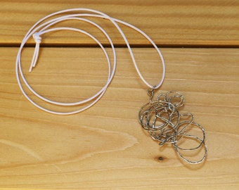 Stainless steel wire pendant necklace worked with wire