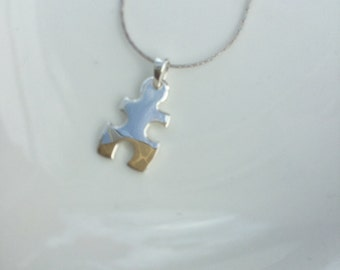Sterling Silver solid jig saw pendant on a chain