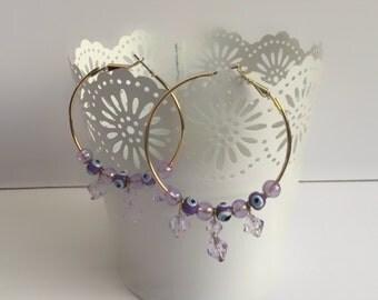 Gold purple beaded hoop earrings