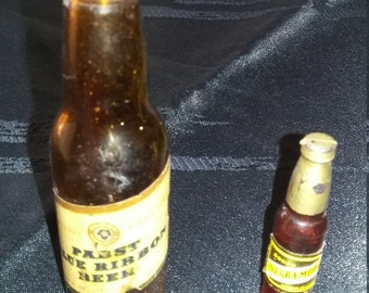 Vintage souvenir beer bottles