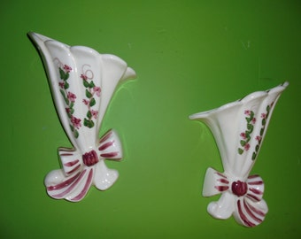 A Pair of flowered wall pockets