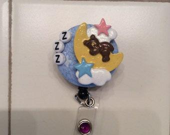 Sleepy teddy on moon baby nursery badge reel holder