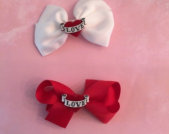 Bows with red heart with love written in it