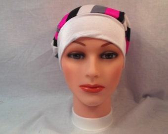 This cap has gray ,white and pink , wide spandex band lots of room. Wear as head cover,runner cap,hat,