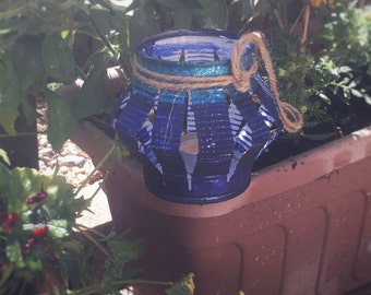 Recycled tin can lantern in blues