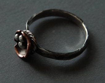 Ring from silver and copper. Size 8.