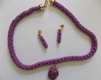 Purple cord with stone.
