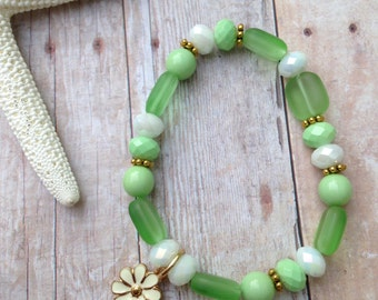 Stackable green bracelet with flower/ daisy charm