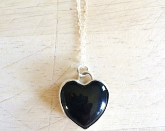 black onyx pendant necklace  . 18 inch sterling silver and black onyx heart   . I love rock n roll