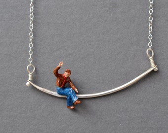 Tiny Figure Necklace- minature waving man in brown jacket