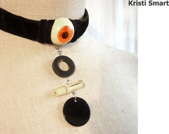 Halloween black velvet choker with scary floating eyeball.