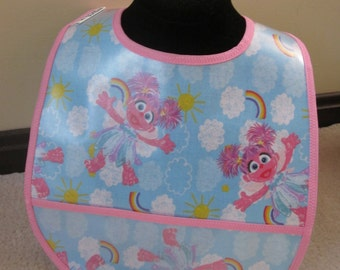 WATERPROOF WIPEABLE Baby to Toddler Wipeable Plastic Coated Bib Abby Cadabby