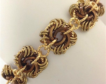 Chocolate Kisses Wrapped In Gold Rosette Bracelet