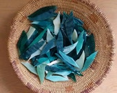 Assorted turquoise glass shards for mosaic art designing