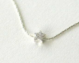 Small sterling silver star necklace