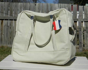 Vintage cream colored American Tourist carry-on travel bag