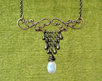 Bronze Flourish Necklace with Rainbow Monstone// swirly feminine curvy luxe antique vintage magic water drop potion brass chains wirework