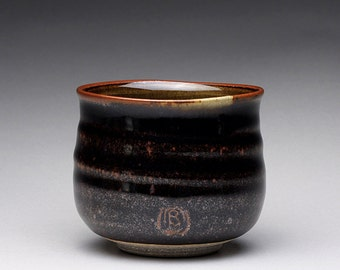 handmade ceramic tea bowl, pottery cup, teacup with black brown tenmoku and green celadon glazes