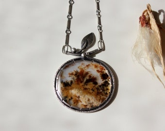 Turning Leaves, a Change in Seasons..............sterling silver, plume agate, leaf pendant