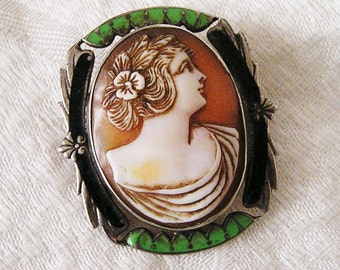 Vintage Lindroth Carved Shell Cameo. Green and Black Enamel on Silver Metal Frame. Sepia Colored Stain Accentuates Carving Details (J112)