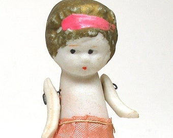 "1930s Bisque doll, Frozen Charlotte with articulated arms, made in Japan. 3""."